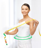 Sporty woman with measuring tape Royalty Free Stock Photos