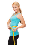 Sporty woman with measuring tape. Diet, sport and heath concept - beautiful sporty woman with measuring tape Royalty Free Stock Photography
