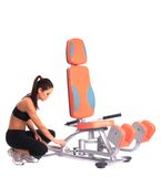 Sporty woman near  isodynamic exerciser Stock Images