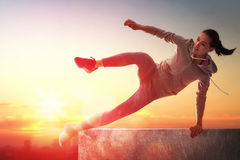 Sporty woman outdoors Stock Photos