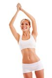 Sporty woman over white rising up hands. Like champion royalty free stock photography