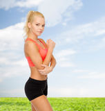 Sporty woman with pain in elbow Royalty Free Stock Photography