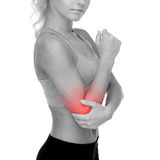 Sporty woman with pain in elbow Royalty Free Stock Photo
