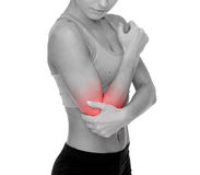 Sporty woman with pain in elbow Stock Image