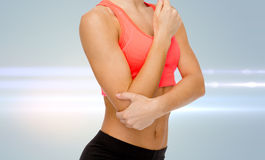 Sporty woman with pain in elbow Stock Images