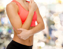 Sporty woman with pain in elbow Royalty Free Stock Images