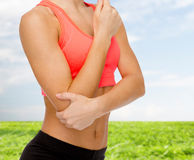 Sporty woman with pain in elbow Stock Photo
