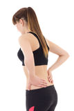 Sporty woman with pain in her back isolated on white. Background stock photos