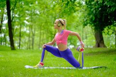 Sporty woman in a park Royalty Free Stock Image