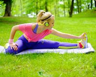Sporty woman in a park Stock Photo