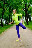 Sporty woman in a park Royalty Free Stock Images