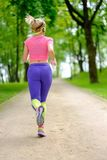 Sporty woman in a park Royalty Free Stock Photo