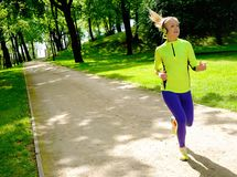 Sporty woman in a park Stock Photography