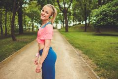 Sporty woman in a park Stock Images