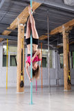 Sporty woman performing pole dance Royalty Free Stock Photo