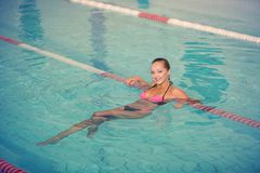 Sporty woman. picture of happy young girl swimming in pool Stock Image