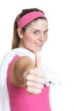 Sporty woman in pink jersey showing thumb Royalty Free Stock Image