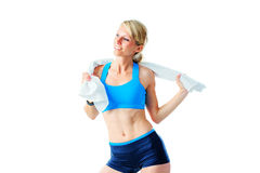 Sporty woman playing with white towel after workout Stock Photos