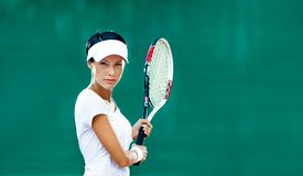 Sporty woman plays tennis Royalty Free Stock Images