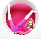 Sporty woman posing in pink circle Royalty Free Stock Images