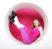 Sporty woman posing in pink circle Royalty Free Stock Photography