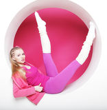 Sporty woman posing in pink circle Stock Images