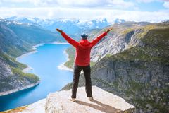 Sporty woman posing on Trolltunga Norway Stock Photo