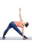 Sporty woman practices Ashtanga Vinyasa yoga asana Royalty Free Stock Photography