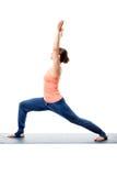 Sporty woman practices yoga asana Royalty Free Stock Photo