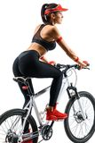 Sporty woman practicing on the bicycle. Active life. Sporty woman practicing on the bicycle in silhouette on white background.  Rear view. Sport and healthy Royalty Free Stock Photos