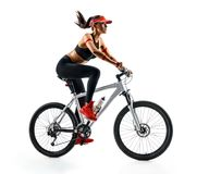 Sporty woman practicing on the bicycle in silhouette on white background. Active life. Sporty woman practicing on the bicycle in silhouette on white background stock photography