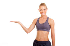 Sporty woman presenting Royalty Free Stock Photography