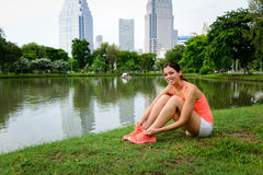 Sporty woman ready for running at city park Royalty Free Stock Photo