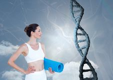 Sporty woman with realistic dna chain against a sky background Royalty Free Stock Photo