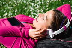 Sporty woman relax in park after workout Royalty Free Stock Images