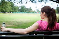 Sporty woman resting Stock Images