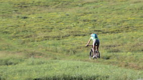 The sporty woman riding bicycle in mountain nature landscape. stock video footage