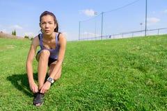 Sporty woman runner preparing for running Stock Photo