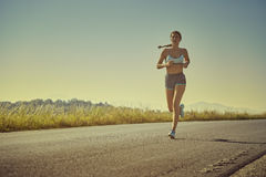 Sporty woman running Royalty Free Stock Photo