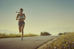 Sporty woman running Royalty Free Stock Image