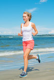Sporty woman running. Stock Photo