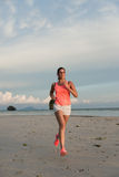 Sporty woman running at the beach Royalty Free Stock Photo