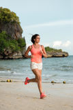 Sporty woman running at the beach Stock Photography
