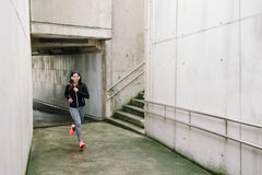 Sporty woman running in the city stock photos