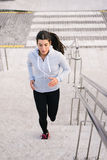 Sporty woman running and climbing stairs Stock Photography