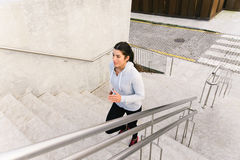 Sporty woman running and climbing stairs Royalty Free Stock Photos
