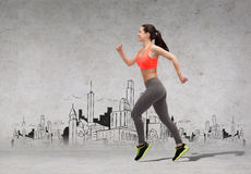Sporty woman running in front of the city drawing Royalty Free Stock Photo