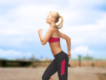 Sporty woman running or jumping Royalty Free Stock Images