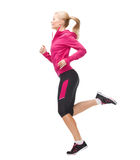 Sporty woman running or jumping Stock Photo