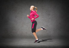 Sporty woman running or jumping Stock Photography
